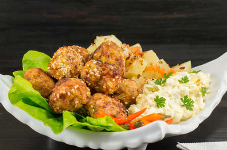 meatballs on a plate decorated with colorful vegetables Stock Photo