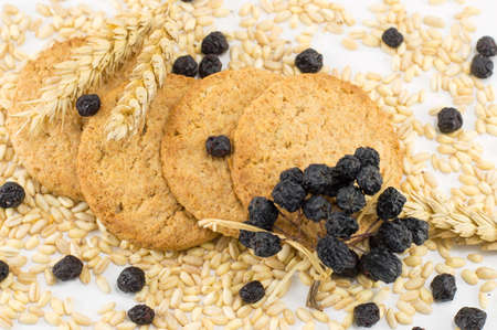Integral bisuits with aronia surrounded with wheat Stock Photo