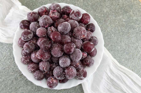 served: Frozen grapes served in a white bowl