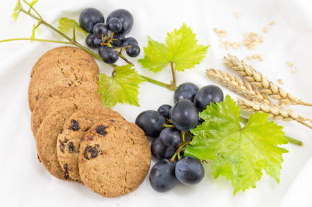 Integral cookies with grapes and wheat  on white