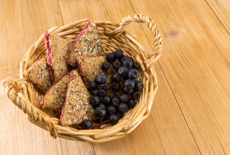 triangle shaped: Sweet integral cookies with aronia fruit on a table