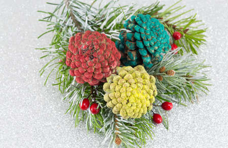 pinecones: Pinecones and fir tree on sparkling background. Christmas decoration background