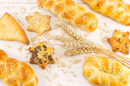 Homemade shaped bread and pastry with wheat plant