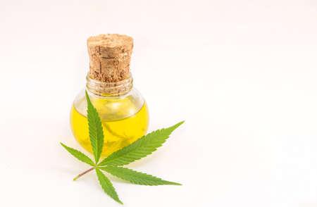 marijuana plant and cannabis oil on white background