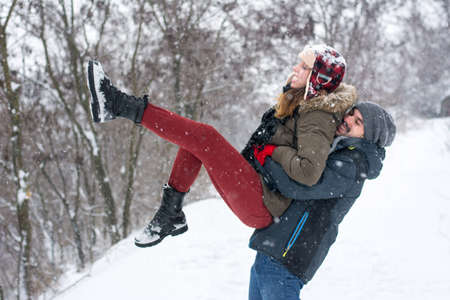 having fun in winter time: Couple having fun in a snow covered park