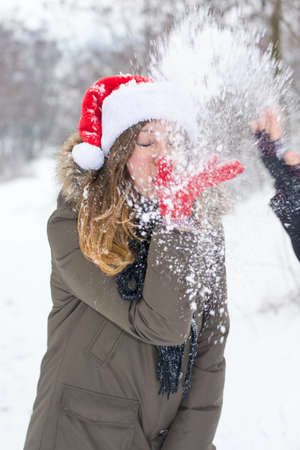 prank: Winter prank. Woman with snow in her face outdoors Stock Photo