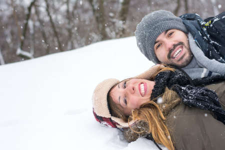 knockdown: Crazy couple having fun in a snow covered park