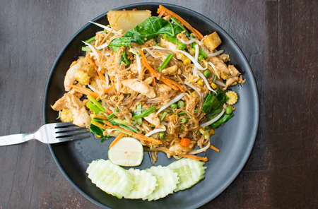 Pad Thai meal served on a black plate Stock Photo