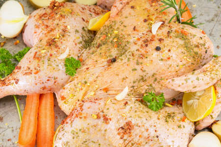 greased: Raw chicken covered with spices ready for cooking Stock Photo