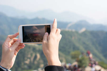 greatwall: Happy tourist taking picture on the Great Wall of China
