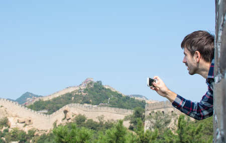 greatwall: Happy male tourist on the Great Wall of China