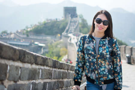 Happy tourist climbing the Great Wall of China