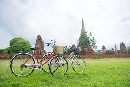Bicycle tour among the ruins of ancient Ayutthaya Kingdom in Thailand
