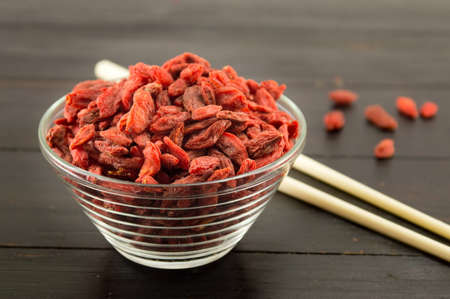 chinese wolfberry: Goji berries in a bowl with Chinese chopsticks