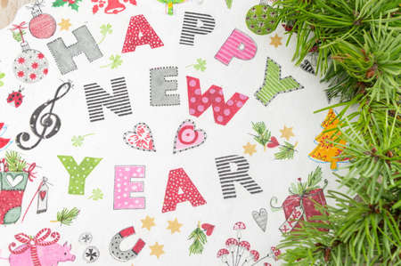 Decoupage New Year decorations made of paper on a plate Banco de Imagens