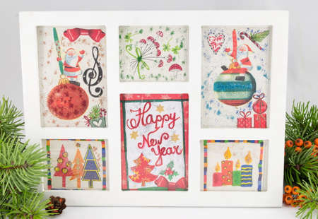 Decoupage New Year decorations made of paper in a frame