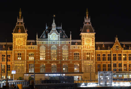 AMSTERDAM, THE NETHERLANDS - 20.09.2015: Night view at the Amsterdam Centraal, the main downtown metro and train station Editorial