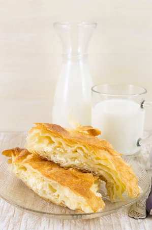Cheese pie with a yogurt on a glass plate