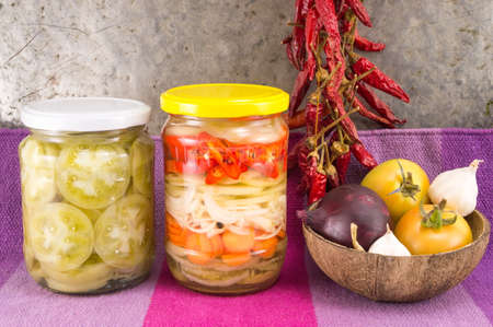 LEGUMBRES SECAS: pickeled vegetables in a jar with onions and dried peppers