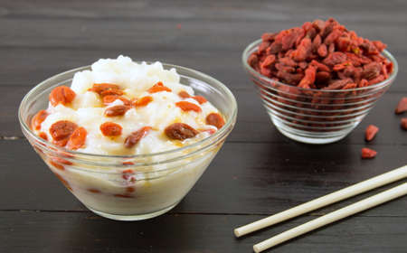 goji berries and rice dessert in a glass bowl