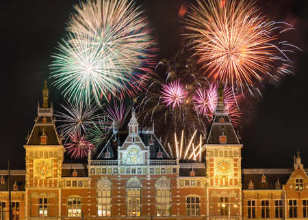 Fireworks above the Amsterdam Centraal, the main downtown metro and train station Фото со стока
