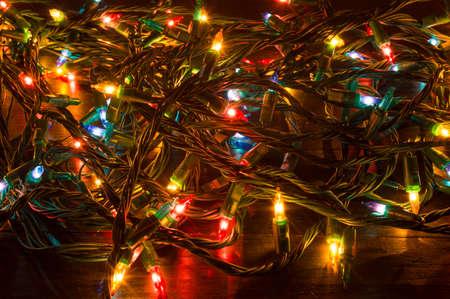 stock photo tangled christmas lights shining on a table - Tangled Christmas Lights