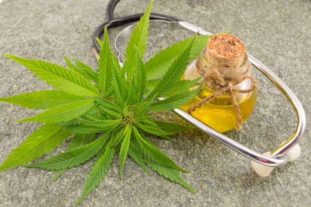 marijuana, cannabis oil and stethoscope. Alternative medicine