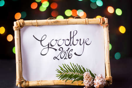 handwirtten goodbye 2016 with star colorful bokeh Stock Photo