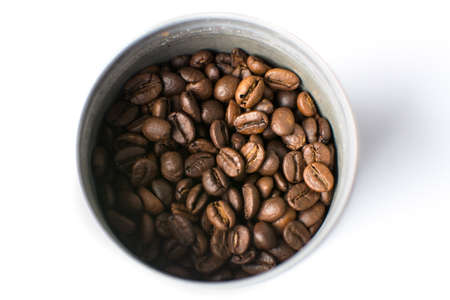 whote: Roasted coffee beans in a metal can