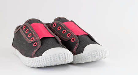 without clothes: Children sneakers without laces on white background