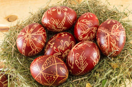 Wax painted red Easter eggs