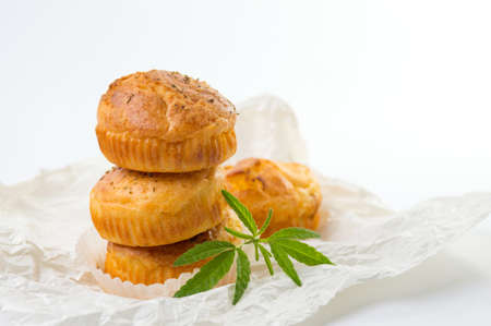 narcotic: Cannabis cupcake muffins and leaves on a cooking paper Stock Photo