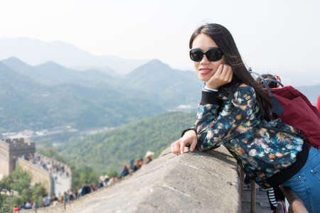 greatwall: Happy girl at the Great wall of China Stock Photo