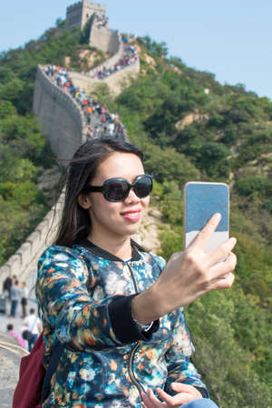 Girl taking selfie at the Great wall of China Stock Photo