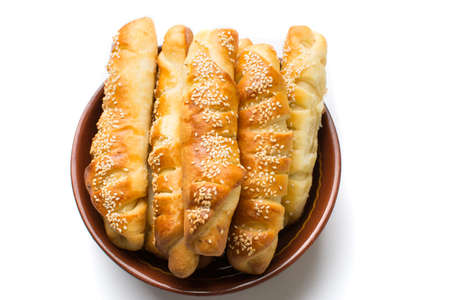 Homemade sesame pastry in a bowl on white Stock Photo