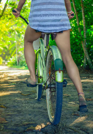 girl cycling on unpaved road in Costarica