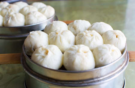 Steamed Chinese Meat Buns Baozi in a bowl Stock Photo