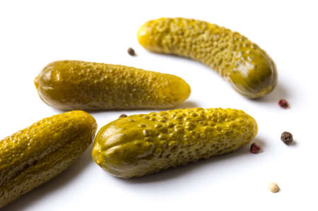 marinated gherkins: Four of pickled cucumbers on white background Stock Photo