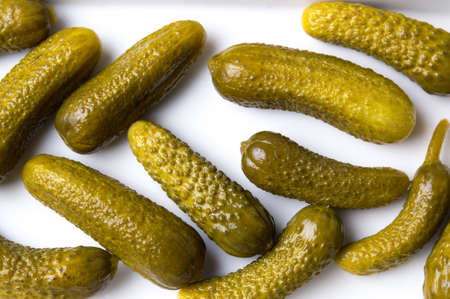 marinated gherkins: Bunch of pickled cucumbers on white background Stock Photo