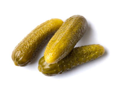 marinated gherkins: Three pickled cucumbers on white background Stock Photo