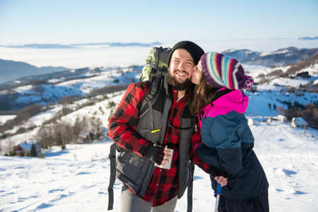 Couple kissing on the snowy mountain pick
