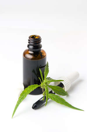 Marijuana and cannabis oil bottle isolated on white