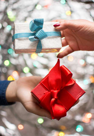 Couple exchanging Valentines presents with festive background Stok Fotoğraf - 71133714