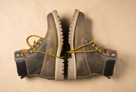 unisex: Unisex brown leather boots with yellow shoelaces