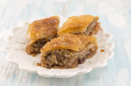 Homemade baklava dessert on a white plate