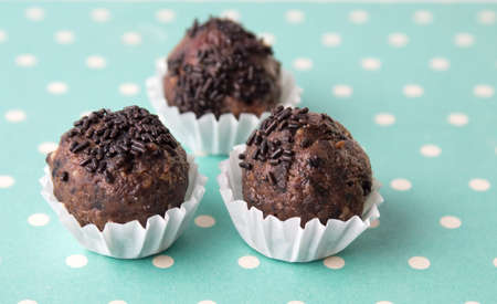 Homemade chocolate truffles in paper holder cups