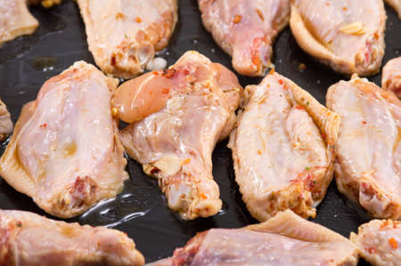 greased: Raw chicken wings with spices ready for roasting