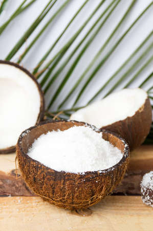 shredded coconut: Coconut powder in a natural shell with leaves Stock Photo