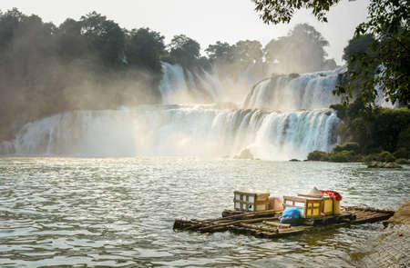View at Detian waterfalls with bamboo raft on water in China 版權商用圖片