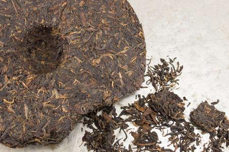 Pu-erh fermented Chinese tea in a roll Banco de Imagens - 73617832